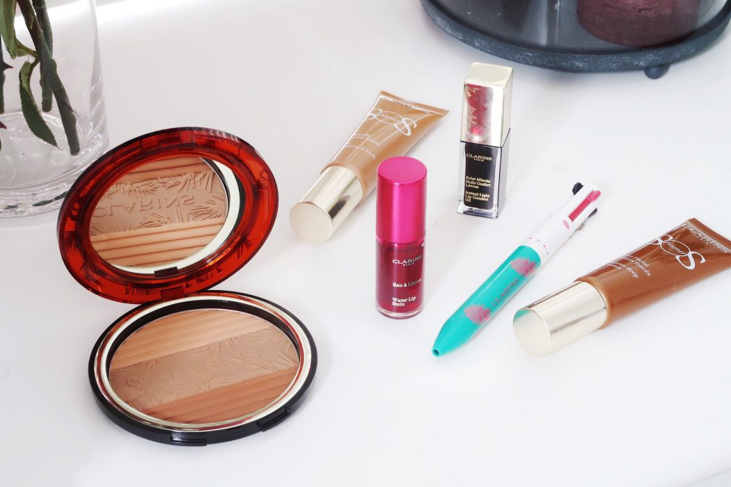 flatlay of products from Clarins summer 2-18 collection