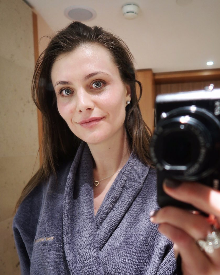 Ewa from Social Beautify blog, taking a picture in the mirror minutes after facial acupuncture treatment with Dr John Tsagaris at Harrods Wellness Clinic