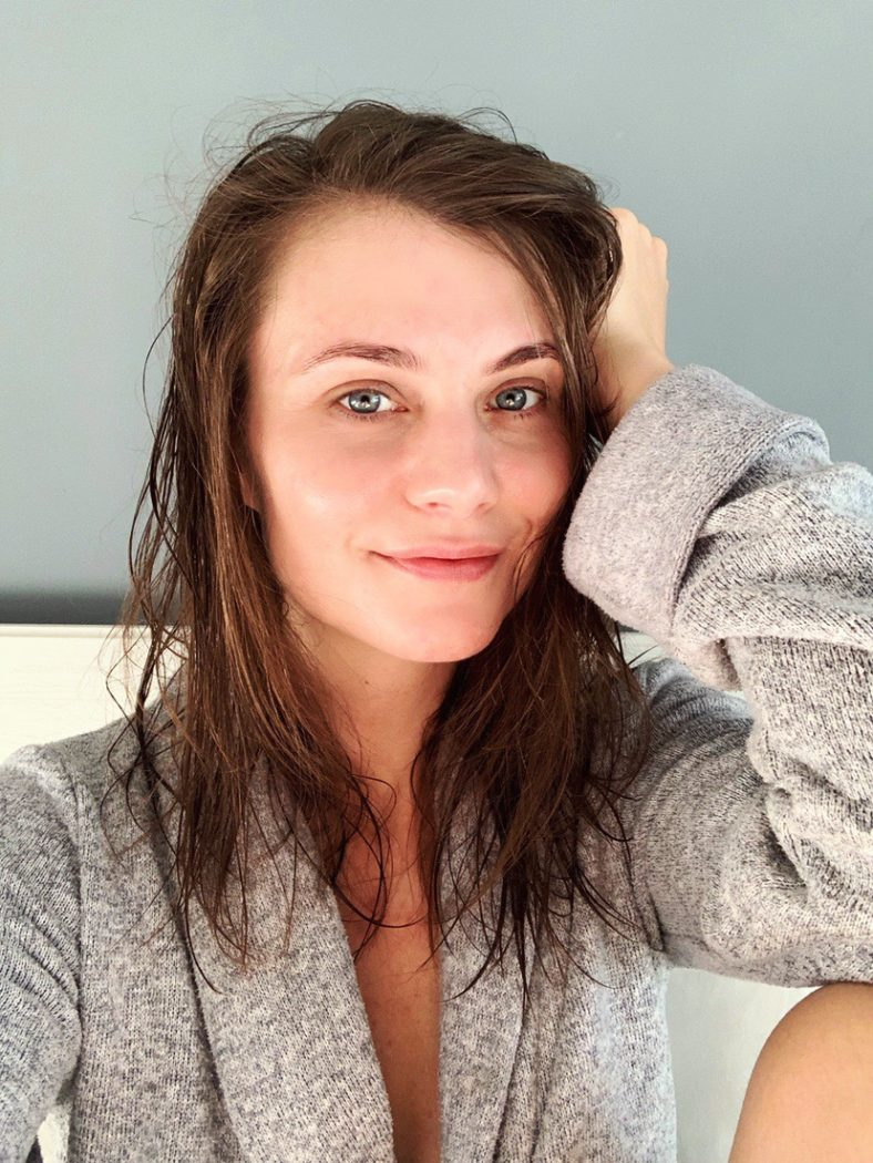 Ewa from SocialBeautify in a dressing gown with wet hair and glowing skin form skincare alone.