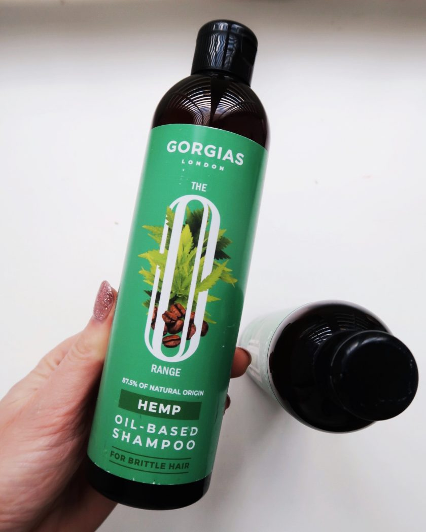 A bottle of Hemp oil-based shampoo for brittle hair.