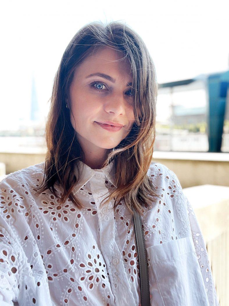 Post hydra facial skin. Beautiful woman in a white shirt.