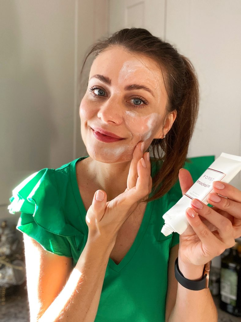 Woman applying FOREO Imagination mask base to the face.